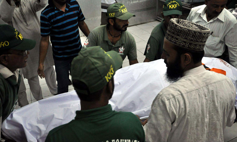 Dead body of Muttehida Qaumi Movement Leader, Sajid Qureshi who assassinated along with his son by unidentified gunmen at Nazimabad, is being  shifted from hospital to home on Friday, June 21. — Photo by PPI