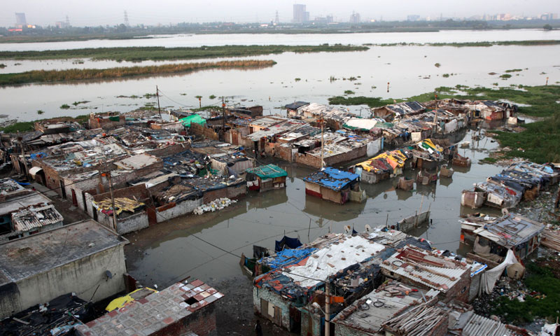 A shanty town along the banks of the Yamuna River lies partially submerged in floodwater, in New Delhi, India, Thursday, June 20, 2013. —AP Photo