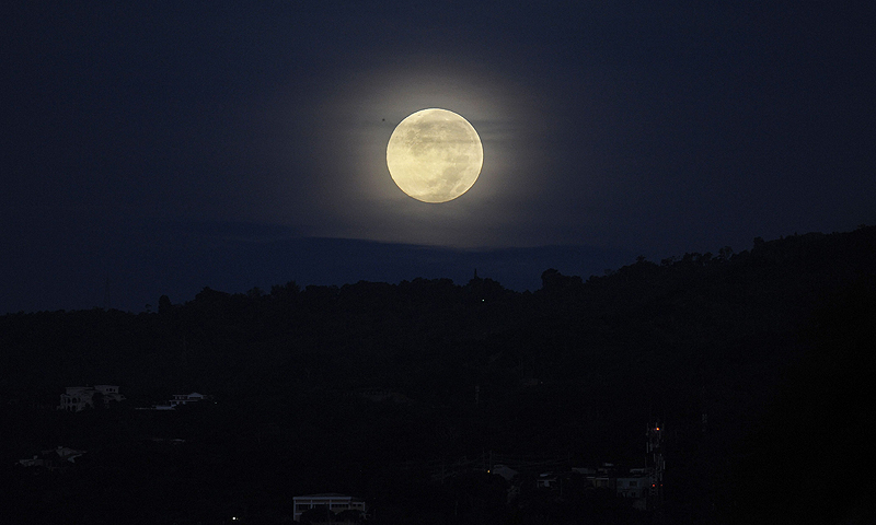 "A full moon over San Salvador, El Salvador. This ""super Moon"" also known as the ""perigee"" full moon appears about 14 per cent larger and 30 per cent brighter than a regular full moon, according to NASA scientists.—Photo by AFP"