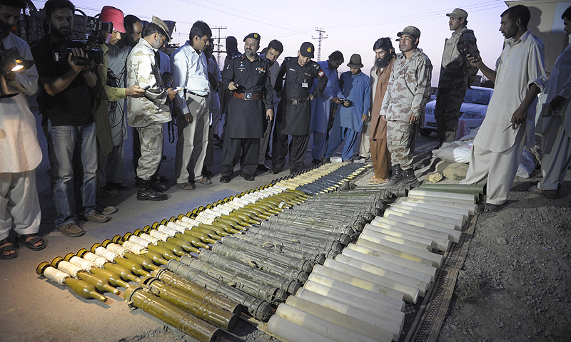 "Pakistani Frontier Corps (FC) and members of the media gather around seized rockets at a check point in Quetta. Local chief of paramilitary Frontier Corps (FC) Colonel Maqbool Ahmad told AFP that ""We intercepted the truck, which was coming from the border town of Chaman on an intelligence tip off and arrested the driver after recovering 50 rockets with fuses"".—Photo by AFP"