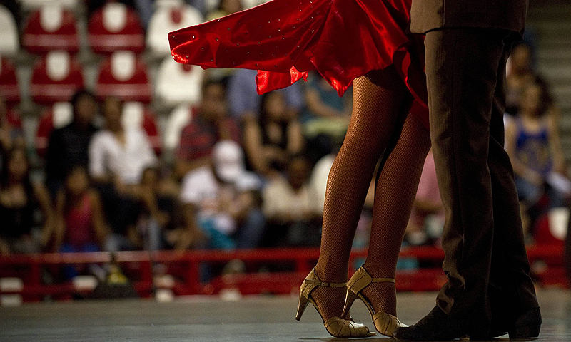 "Colombian tango dancers Valentina Valencia and Cristian Montoya perform during the Third World Tango Championships as part of the ""VII International Tango Festival"", in Medellín, Antioquia department, Colombia.—Photo by AFP"