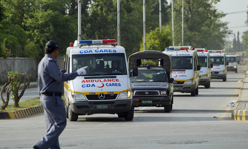 A traffic warden guides ambulances carrying the bodies of foreign tourists killed by unidentified gunmen near the Nanga Parbat peak. Gunmen stormed a mountaineering base camp in northern Pakistan on Sunday and shot dead nine foreign trekkers and a Pakistani guide as they rested during an arduous climb up one of the world's tallest peaks, police said.—Photo by Reuters