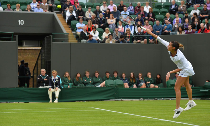 Italy's Flavia Pennetta serves against Britain's Elena Baltacha during their first round match.