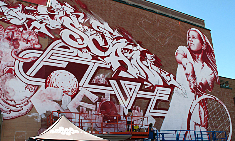 A mural is seen on the side of a building during the Mural Festival on June 6, 2013 in Montreal, Canada. The festival is the first of its kind in Canada, an open-air museum featuring work by some 35 artists from around the world. — AFP Photo