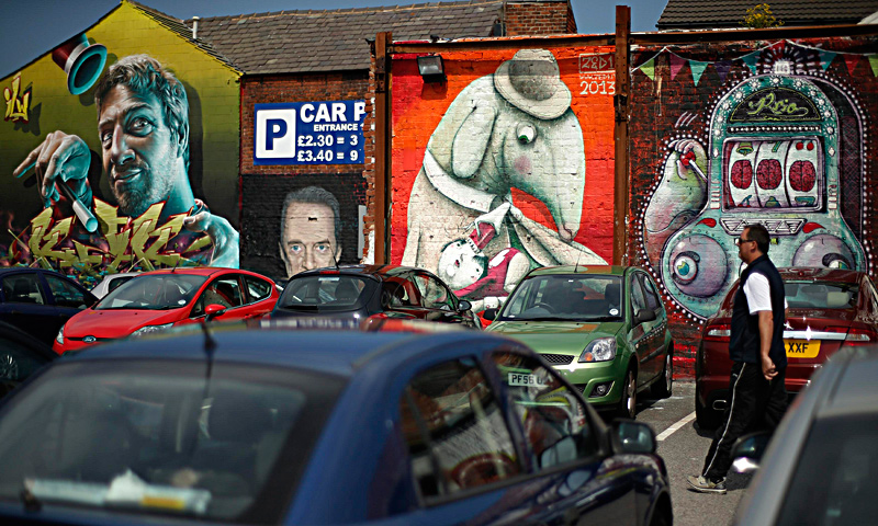 "A mural is seen painted on a wall in Blackpool, northern England June 18, 2013. The mural is part of the ""Sand, Sea and Spray"" outdoor art festival, which has seen 40 urban artists from around the world paint murals on buildings across the town centre. — Reuters Photo"