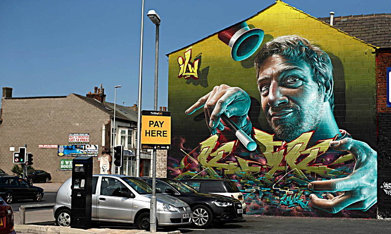 "A mural is seen on a wall in Blackpool northern England, June 18, 2013. The mural is part of an outdoor art festival, ""Sand, Sea and Spray"" which has seen 40 urban artists from around the world paint murals on buildings across the town centre. — Reuters Photo"