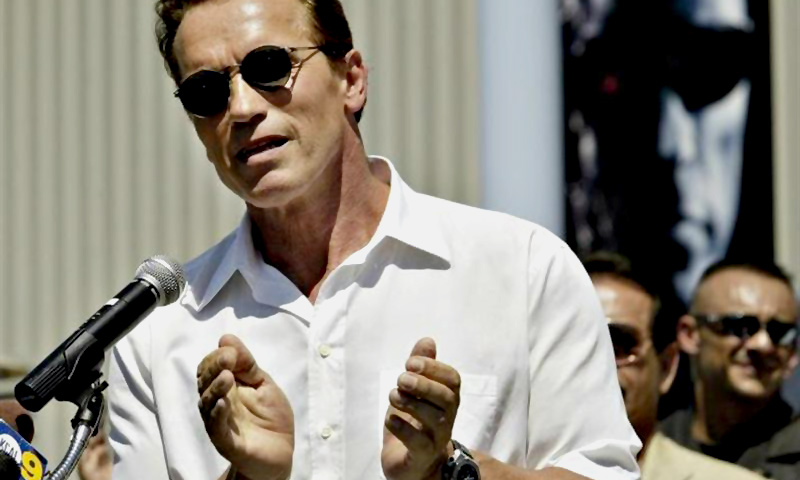 With a poster from his latest film ''Terminator 3'' in the background, actor Arnold Schwarzenegger applauds youths in attendance at opening ceremonies of the Inner-City Games at the Hollywood Sports Center in Bellflower, California, August 8, 2003. — Reuters Photo