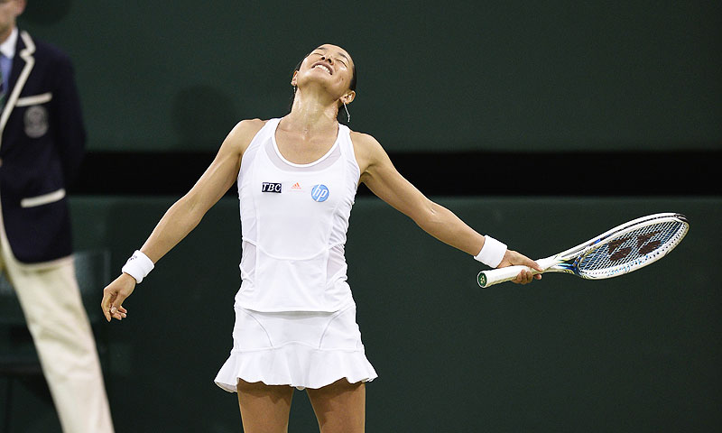 Japan's Kimiko Date-Krumm reacts after losing a point to US player Serena Williams. -Photo by AFP
