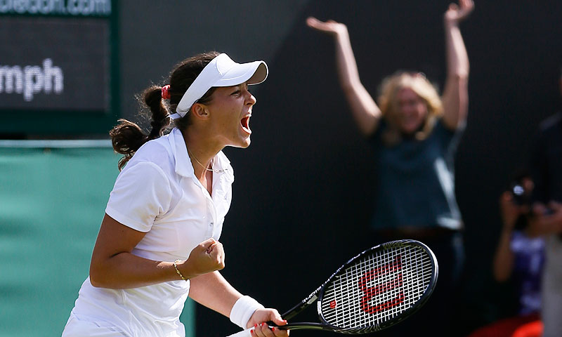 Laura Robson of Britain celebrates after beating Marina Erakovic of New Zealand. -Photo by AP