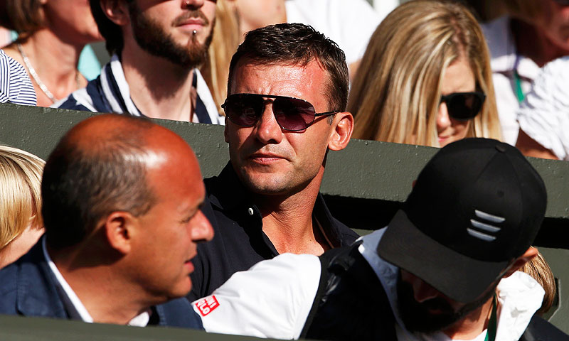 Andriy Shevchenko (C), former Chelsea soccer player and now a Ukranian politician, sits on Centre Court. -Photo by Reuters