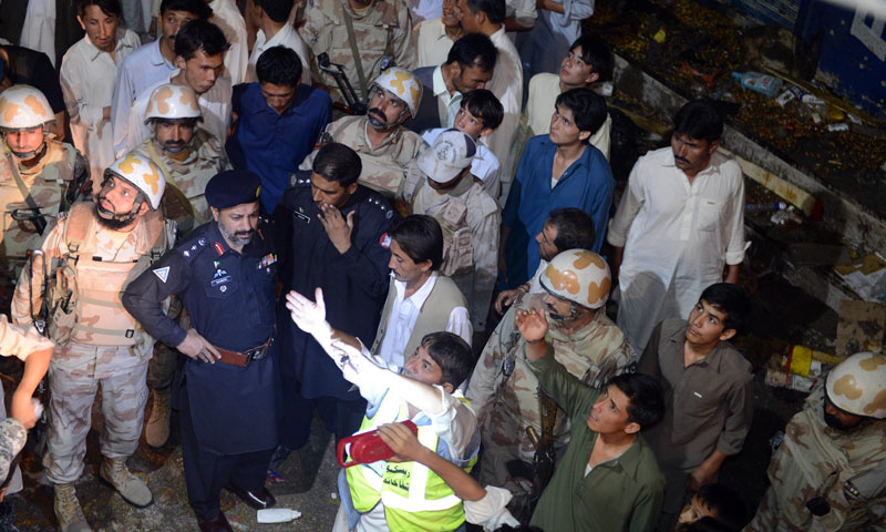 Pakistani rescuers and security officials gather at the suicide attack site in Quetta on June 30, 2013. — Photo by AFP