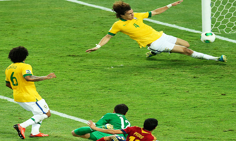 Brazil's David Luiz deflects a ball by Spain's Pedro Rodriguez - Photo by AP
