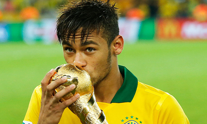 Brazil's Neymar kisses the Confederations Cup trophy after winning the final - Photo by AP
