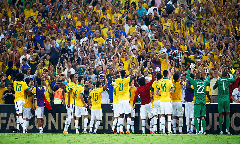 Brazil's players celebrate with their supporters after winning - Photo by Reuters