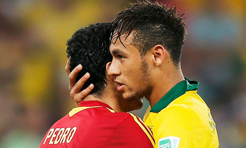 Brazil's Neymar is congratulated by Spain's Pedro - Photo by Reuters