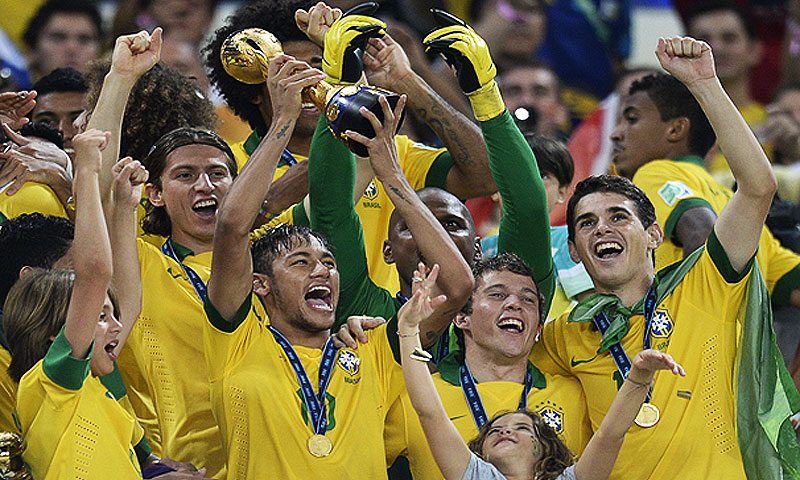 The Brazillians celebrate with the Confederations cup trophy - Photo by AFP
