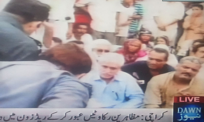 Video still from DawnNews footage shows demonstrators holding a sit-in protest outside the Ranger's headquarters in Karachi on July 1, 2013.