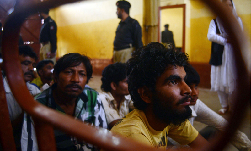 Indian fishermen wait for transport following their release from prison in the Pakistani port city of Karachi on May 24, 2013. – AFP Photo
