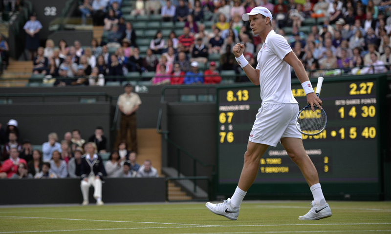Czech Republic's Tomas Berdych celebrates winning the third set to take the lead against Australia's Bernard Tomic during their fourth round men's singles match on day seven of the 2013 Wimbledon tennis tournament.