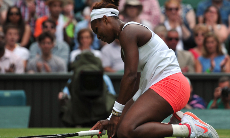 US player Serena Williams goes to her knees as she loses a game in the final set against Germany's Sabine Lisicki during their fourth round women's singles match on day seven of the 2013 Wimbledon  tennis tournament.