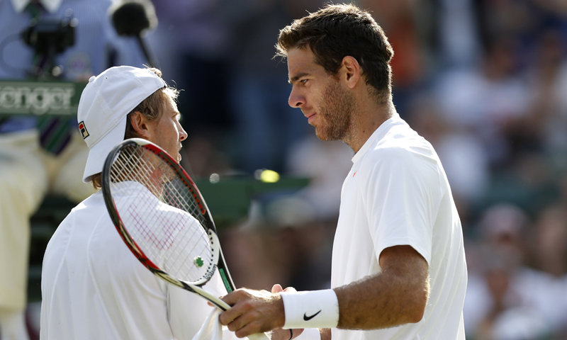 Juan Martin Del Potro of Argentina shakes hands with Andreas Seppi of Italy after defeating him in their Men's singles match.