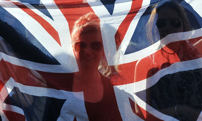 Tennis fans hold up a Union Flag in front of the big screen at Murray Mount as Britain's Andy Murray beats Russia's Mikhail Youzhny in their fourth round men's singles match.