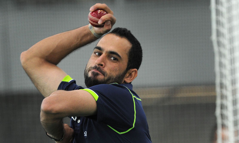This file picture shows Fawad Ahmed bowling at cricket nets