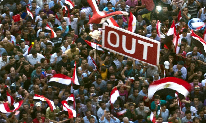 Egyptian protesters calling for ouster of President Morsi  gather in Cairo's landmark Tahrir Square on July 2, 2013. —AFP Photo