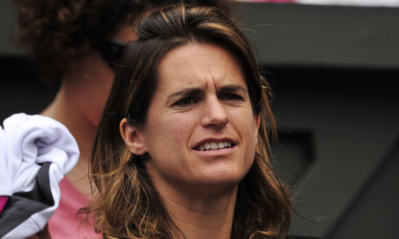 2006 Champion Amelie Mauresmo watches her French compatriot Bartoli in action