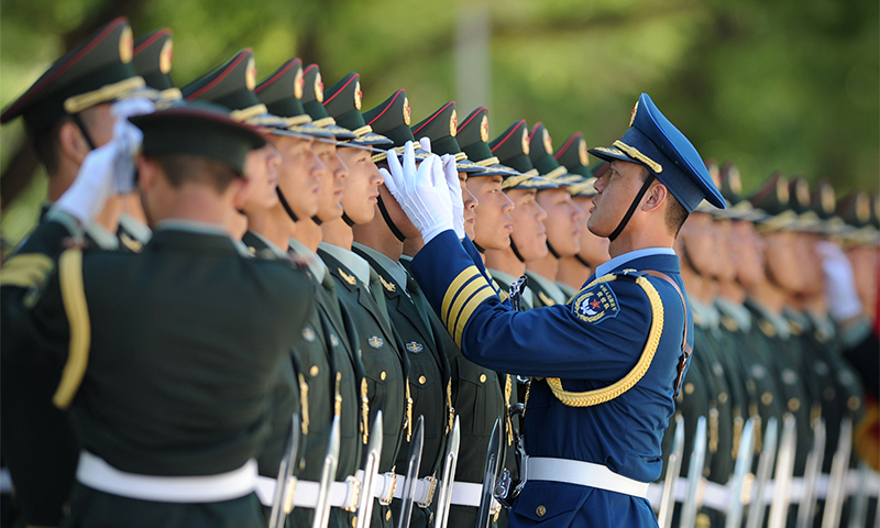 Chinese honour guards await the arrival of Pakistan's Prime Minister Nawaz Sharif. — AFP Photo