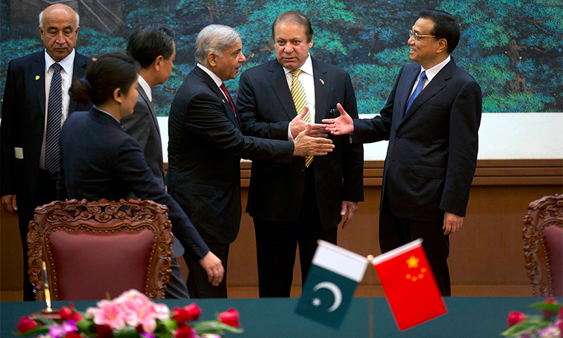 Nawaz Sharif introduces Punjab Chief Minister Shahbaz Sharif to China's Premier Li Keqiang — Reuters