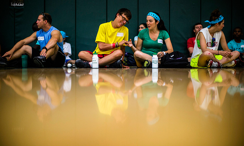 Jordan Vieira (2nd L) sits with counselor Stephanie Connolly (2nd R) at Camp Abilities in Brockport, New York.