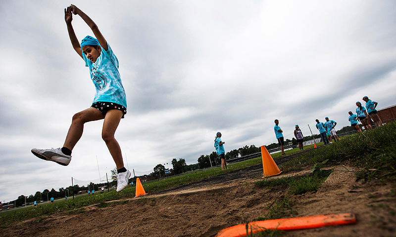 Dah Ku participates in long jump at Camp Abilities in Brockport, New York.