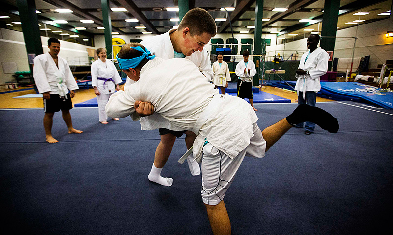 Nicholas Walker takes part in Judo with a counselor at Camp Abilities in Brockport, New York.