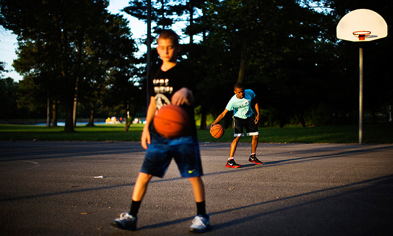 Wayne Eberson (R) plays basketball at Camp Abilities in Brockport, New York.