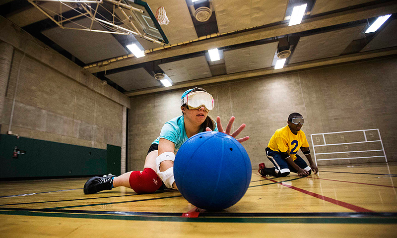 Meghan Fink (L) and Wayne Eberson take part in goal ball at Camp Abilities in Brockport, New York.
