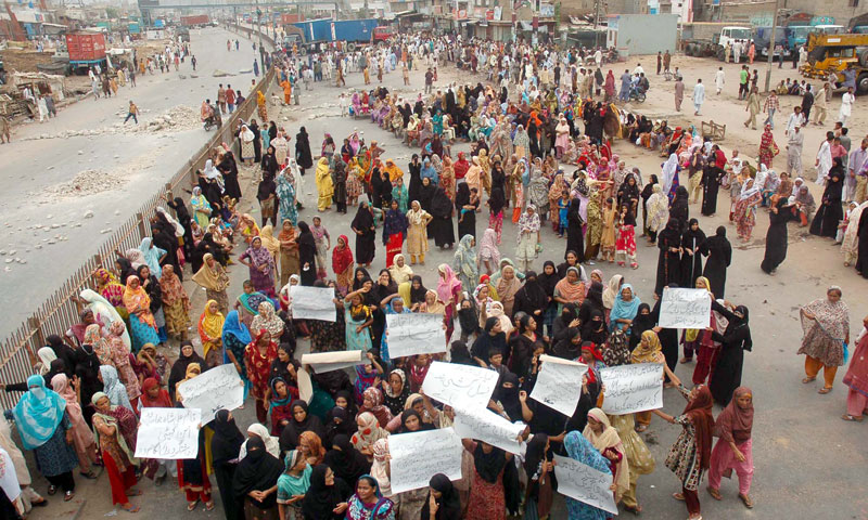 Residents of Lyari stage a protest rally at Mauripur Road, Karachi on July 5, 2013.—Photo by Online