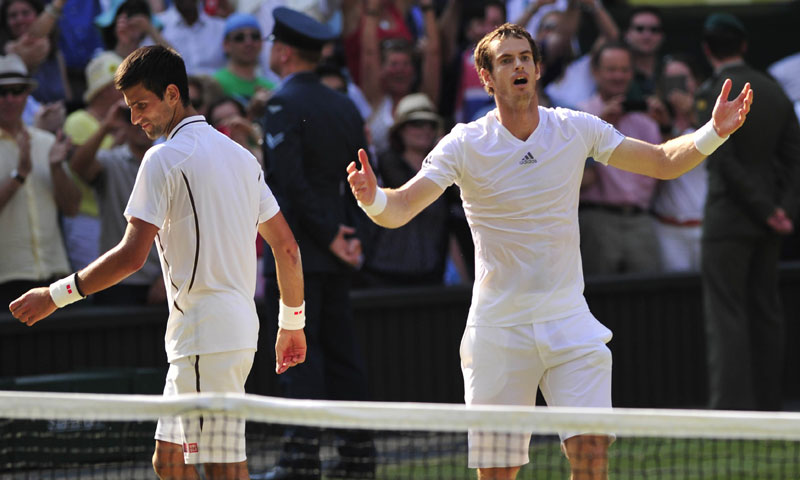 Britain's Andy Murray (R) celebrates beating Serbia's Novak Djokovic (L) during the men's singles final at Wimbledon, southwest London, on July 7, 2013. – AFP Photo