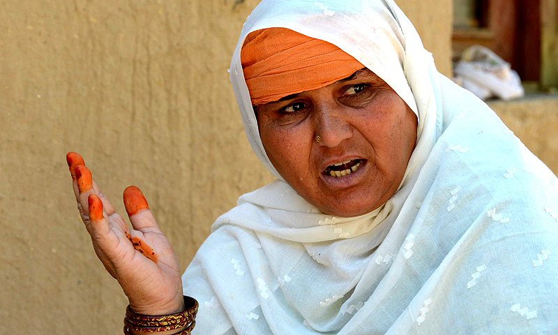 Jan Bano, the mother of an acid victim Tahira, speaks during an interview. -Photo by AFP