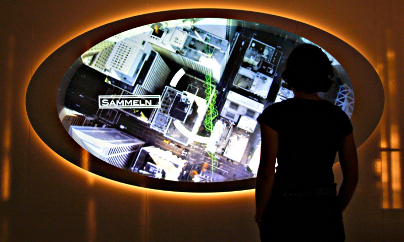 A visitor looks at a video screen at the 'Top Secret' Spy Museum in Oberhausen, July 10, 2013.