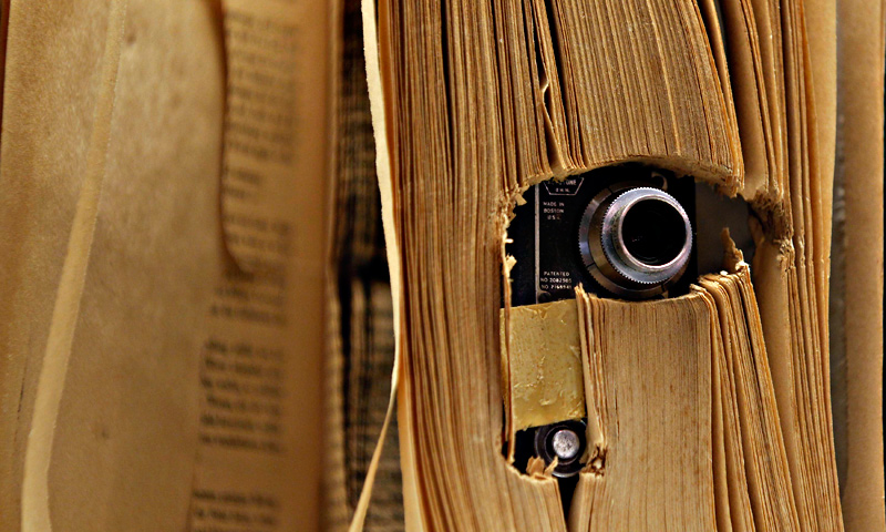 A small photo camera placed in a book and used by the U.S. Central Intelligence Agency (CIA), is displayed at the 'Top Secret' Spy Museum in Oberhausen