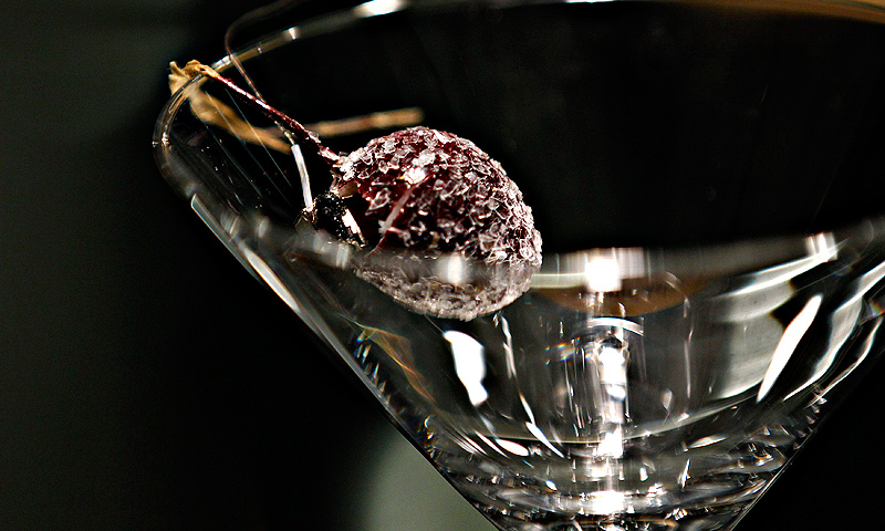 A microphone is concealed inside an artificial cherry placed in a martini glass at the 'Top Secret' Spy Museum.