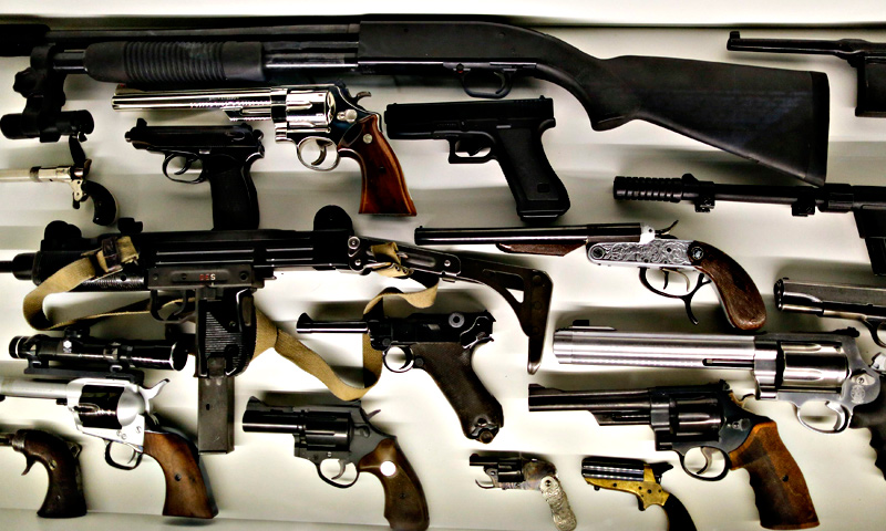 Different kinds of arms used by spies are seen on display at the 'Top Secret' Spy Museum in Oberhausen.