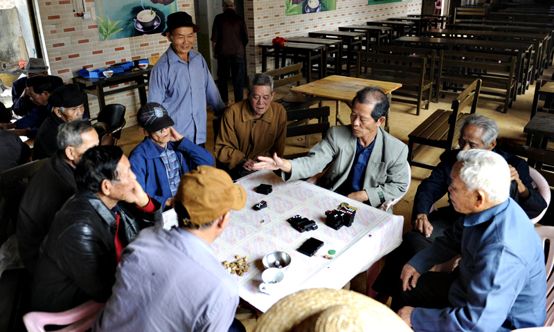 A group of elderly men playing at a tea house.