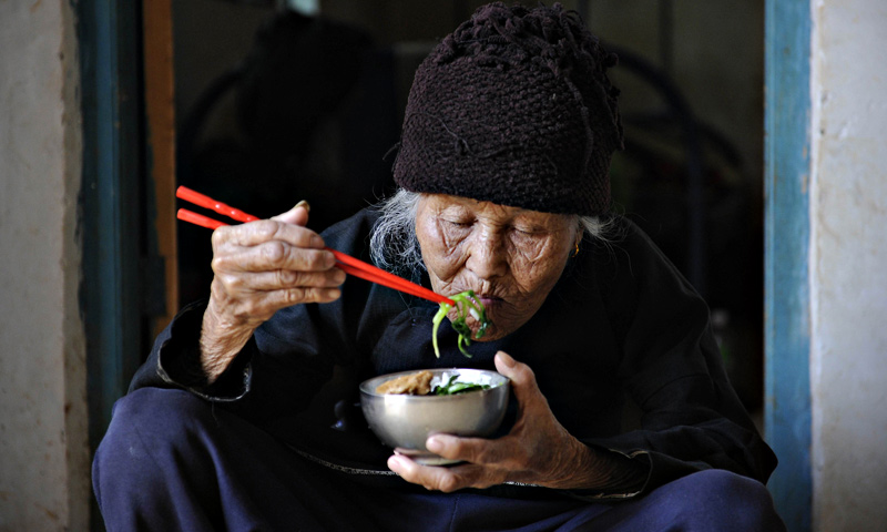 Xu Yuhe, one hundred and three -year - old elderly woman, having her lunch at her house in Chengmai city.