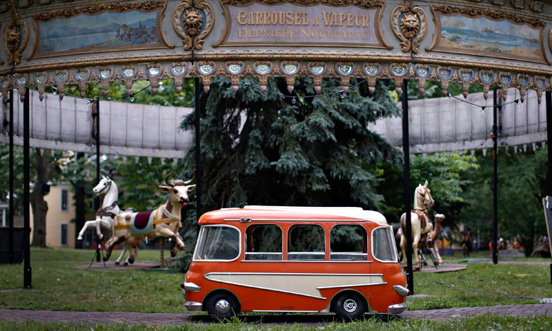 "A miniature bus ride is seen during a media preview of ""Fete Paradiso"". — Reuters Photo"