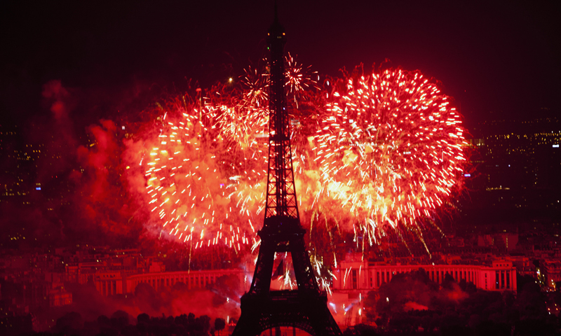 Fireworks illuminate the Eiffel Tower in Paris during Bastille Day celebrations late Sunday, July 14, 2013. — AP Photo
