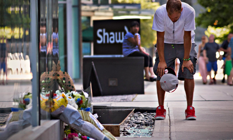 Richard Monteith, cousin of Canadian actor Cory Monteith, pauses at a small memorial outside a downtown hotel in Vancouver. — Reuters Photo