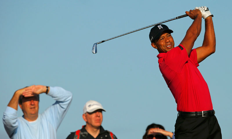 Tiger Woods of the US watches his tee shot on the fourth hole.