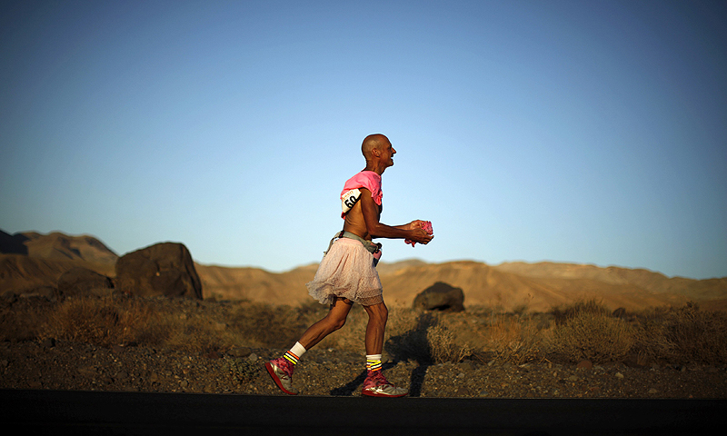 Keith Straw, 58, competes during the Badwater Ultramarathon dressed in a tutu in Death Valley National Park. The 135-mile (217 km) race, which bills itself as the world's toughest foot race, goes from Death Valley to Mt. Whitney, California in temperatures which can reach 130 degrees Fahrenheit (55 Celsius).—Photo by Reuters